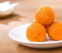 Pile of orange Indian sweets Motichoor Laddu or Laddoo